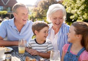 grandparents-with-grandchildren-enjoying-outdoor-XF3MYJP